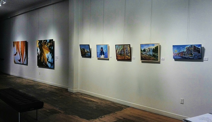 Gallery wall with paintings at the Arts Project in London Ontario