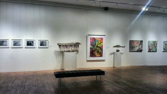 Gallery wall with photos and sculptures in the Arts Project in London Ontario