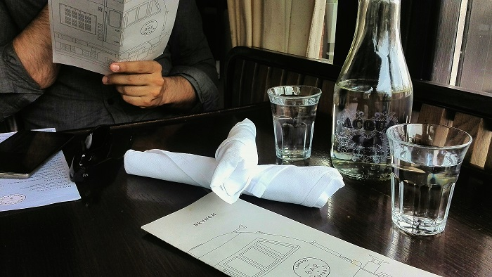 Glass water carafe and brunch menu at Bar Centrale