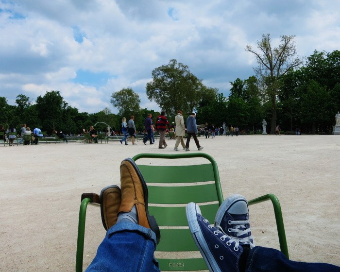 Feet resting on a chair in the Tuileries Paris