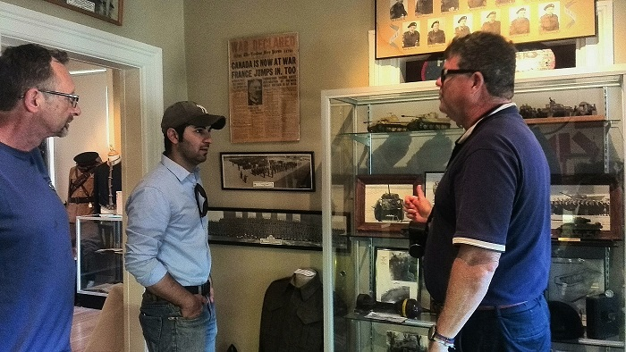Listeing to tour guide during Doors Open London Ontario at the 1st Hussars Museum