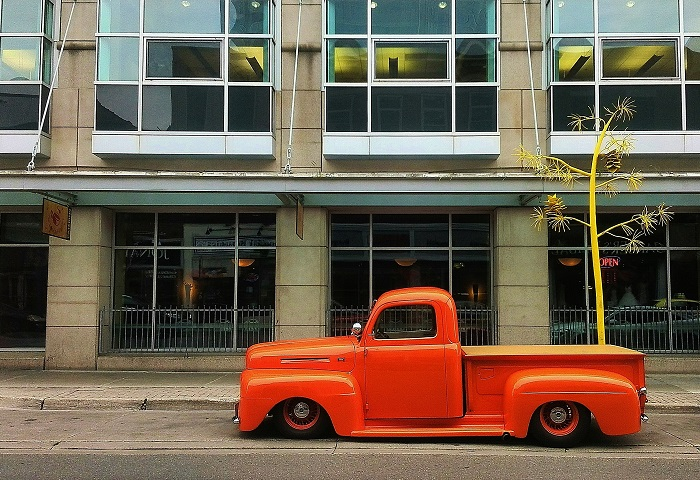 Orange Ford truck  on the street