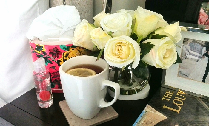 Bed side table with tea and flowers