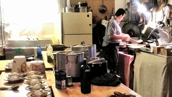 Enzo cooking in the kitchen studio at Massimo Bruno's Supper Club
