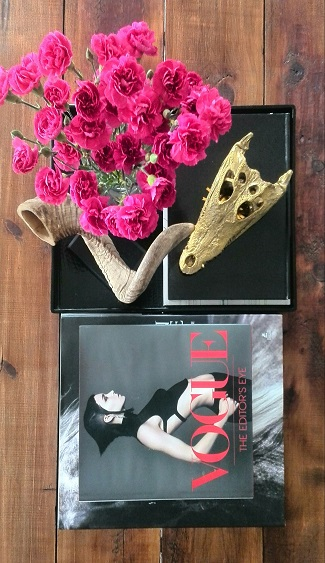 Pink carnations with coffee table books