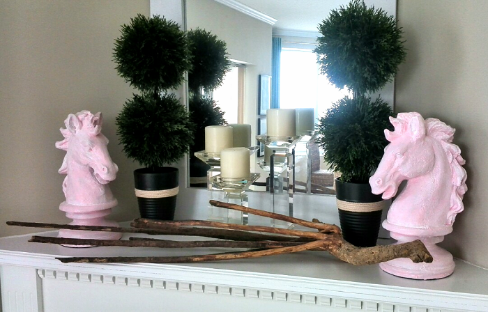 Pink horse statues on fireplace