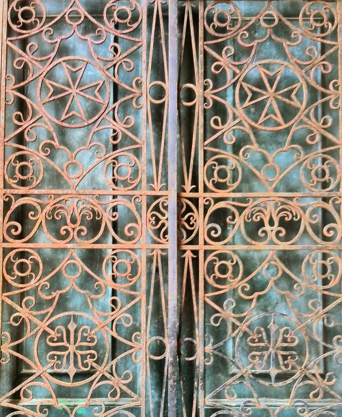 Metal Scroll work with Maltese Cross in Valletta