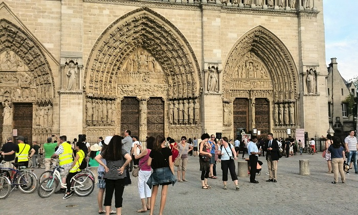 Crowds gathered in front of Cathedral Notre Dame in Paris