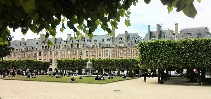 Relaxing at Place des Vosges in Paris
