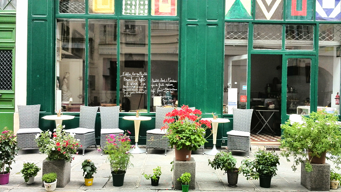 Cafe front and flowers on the streets of Paris