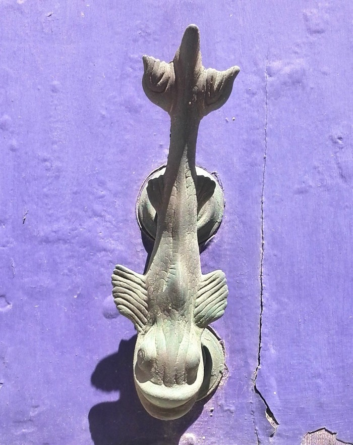 Stylized dolphin on purple door, Valletta, Malta