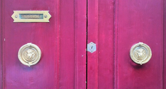 Lion head knocker on purple door, Gozo