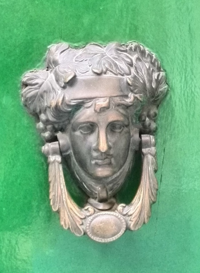 Bacchus face knocker on green door, Gozo