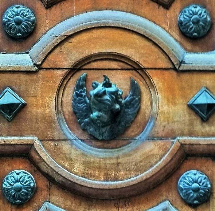 Detail of angel knocker on wood door, Valletta, Malta