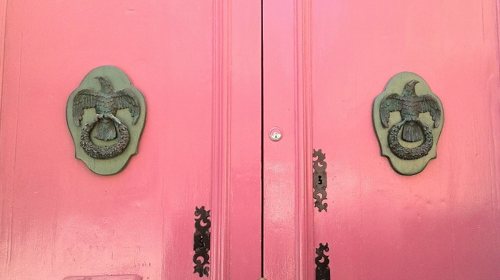 Eagle knocker on pink door, Malta