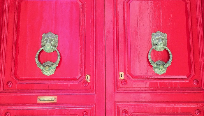 Lion head knocker on red door, Malta