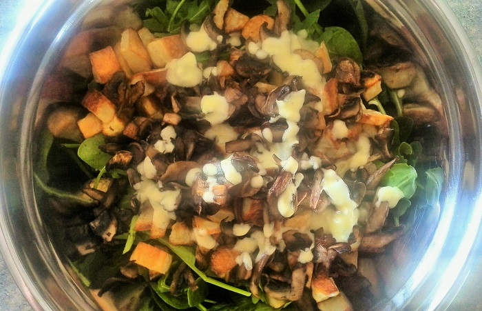 Roasted potato and mushroom salad topped with dressing